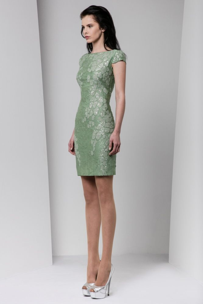 Short fitted olive green organza cloqué dress with cap sleeves, featuring applique sequin embellishments.