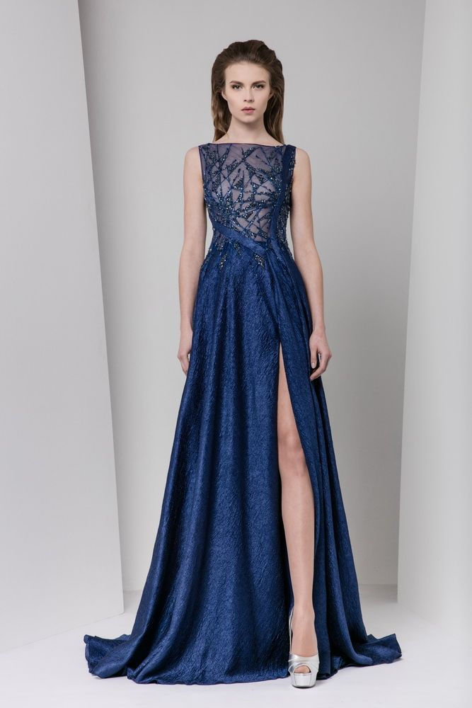 Midnight blue organza cloqué evening dress with a side slit, featuring patchwork embroideries on a sheer bodice corseted with two asymmetrical bands.