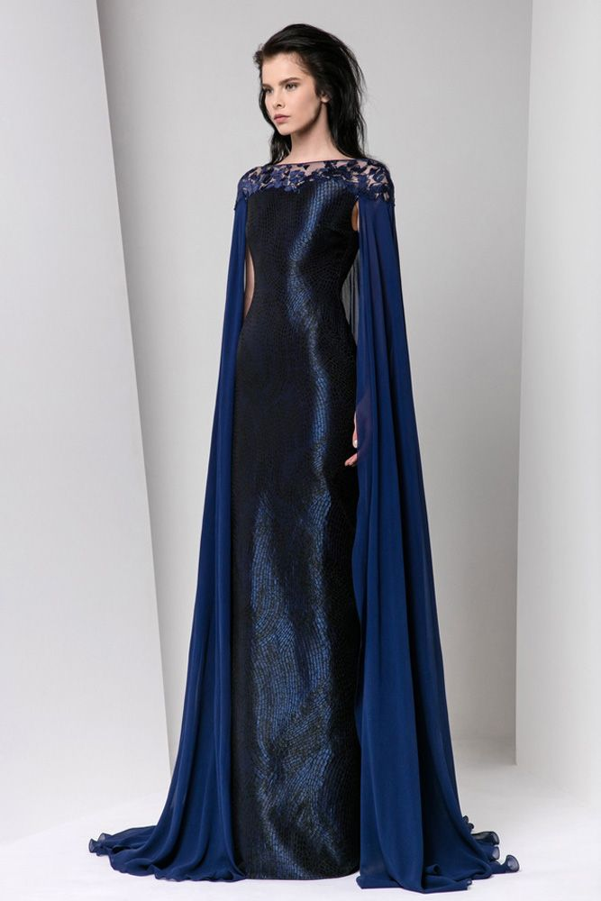 Midnight blue Jacquard lamé sheath dress with a georgette cape featuring silk embroideries on the neckline.