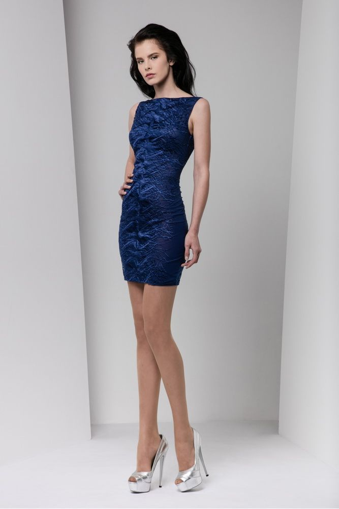 Short fitted midnight blue dress with bateau neckline, embellished with silk thread embroidery.