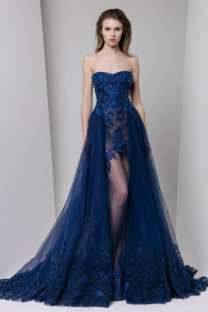 Midnight blue semi sweetheart lace dress embellished with patchwork embroidery and a tulle overskirt.