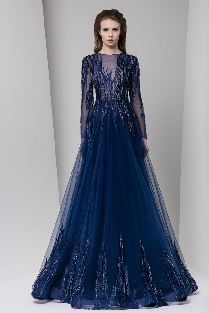 Long sleeve midnight blue A-line tulle evening dress with cascading silk embroidery on a sheer bodice and hemline.