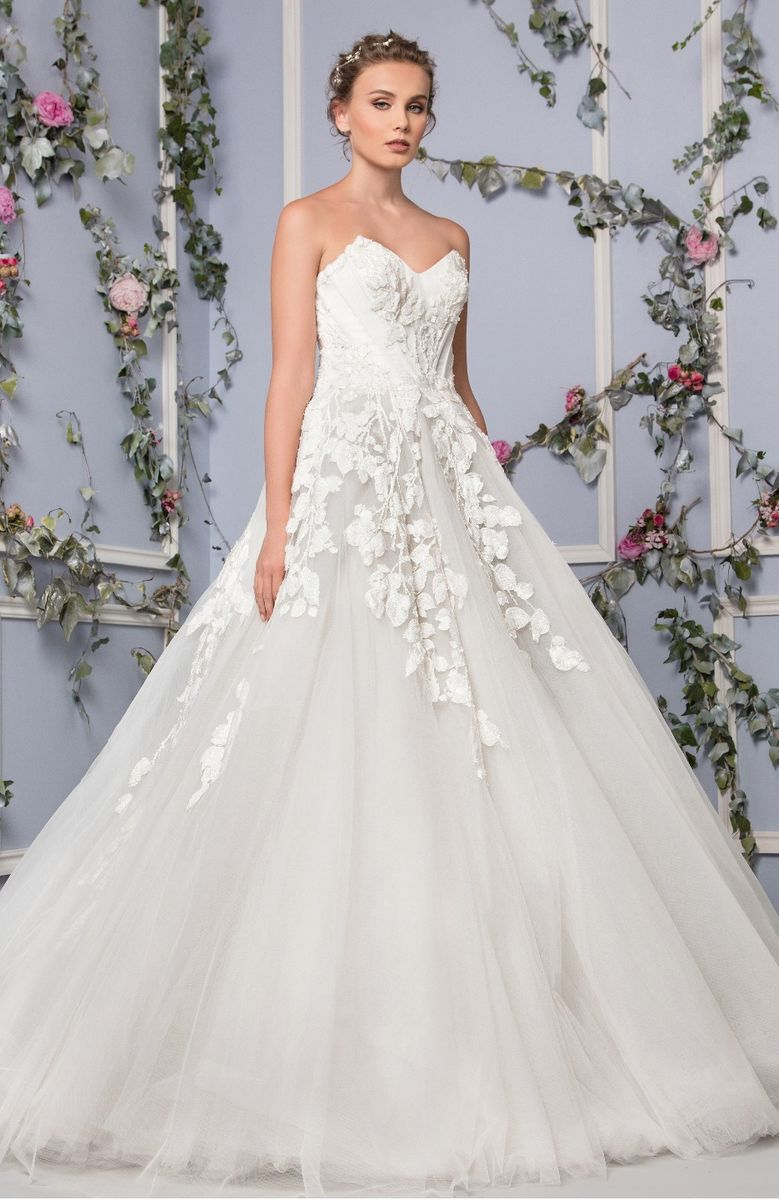 Sweetheart princess Off White Tulle dress with cascading flower applique embroidery and wires on the bust.