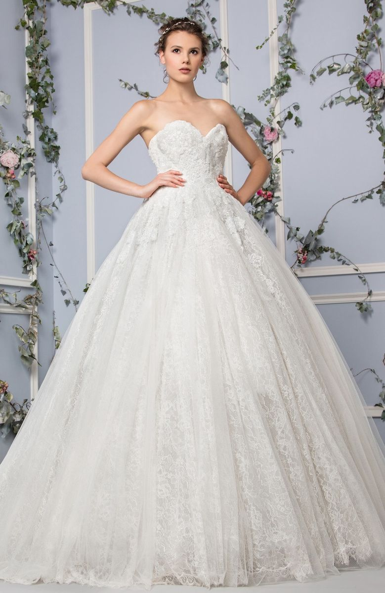 Sweetheart Off White strapless princess dress made of layers of embroidered Lace and a fully embroidered bodice.