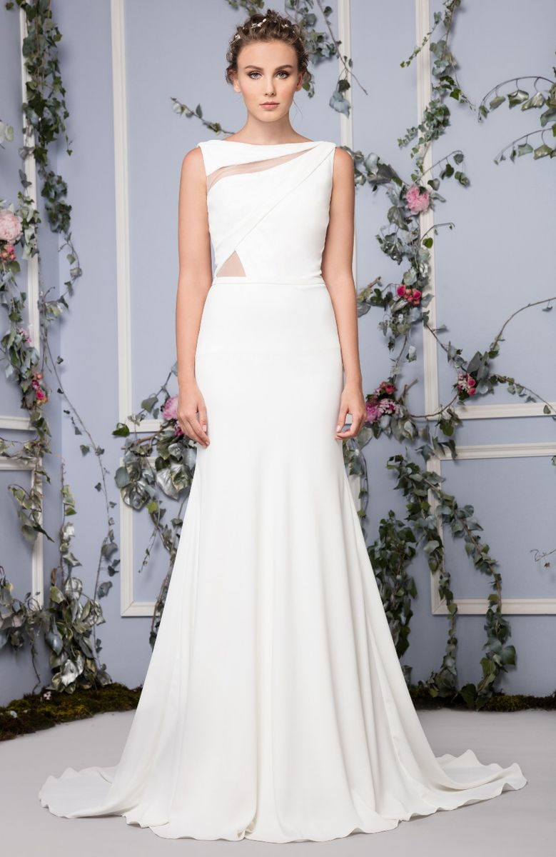 Georgette wedding dress with an asymmetrical cutout bodice and a train.