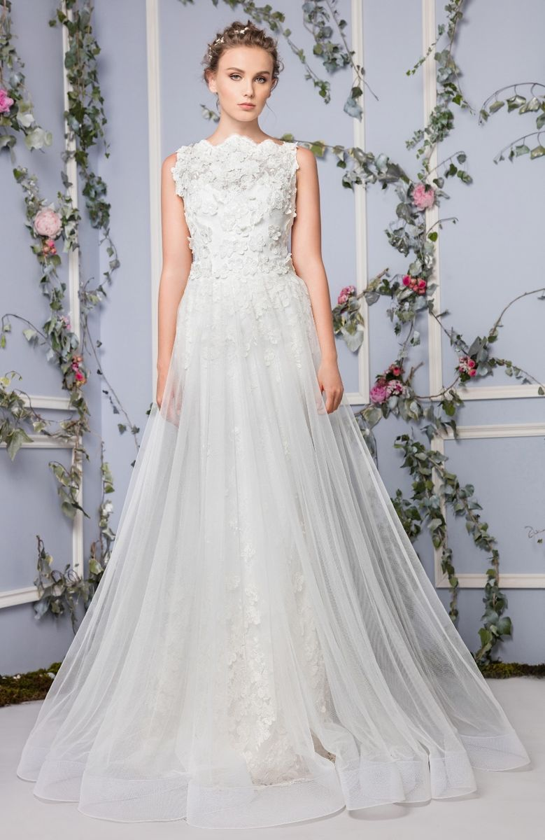 Bateau neckline wedding dress made of flower-embroidered Tulle and a Tulle overskirt.