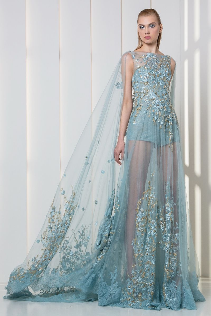 Ice blue lace romper with a sheer overskirt and cape, embroidered with silk flowers and gold crystals.