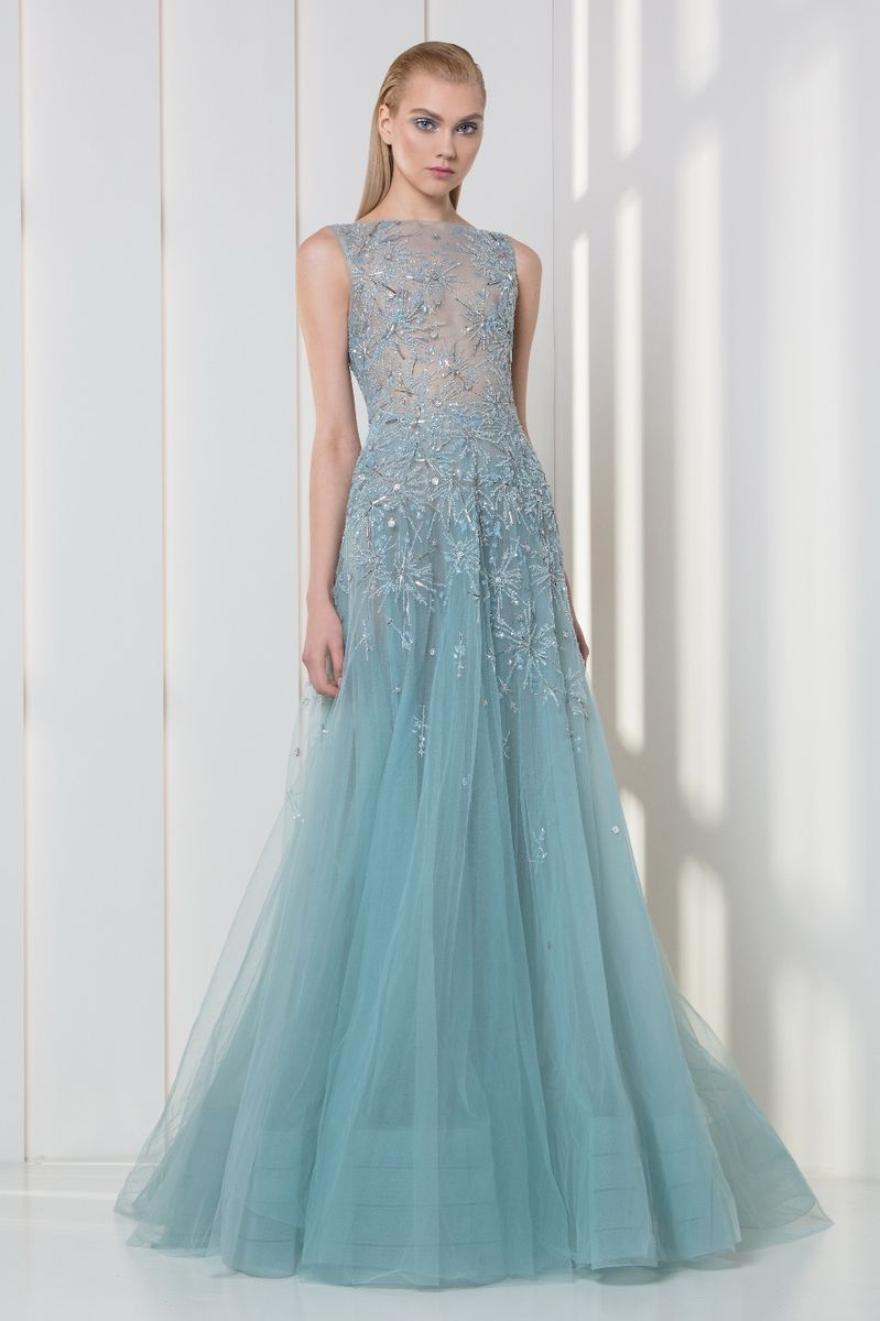 Ice blue tulle dress embellished with crystal and pearls embroidered snowflakes.