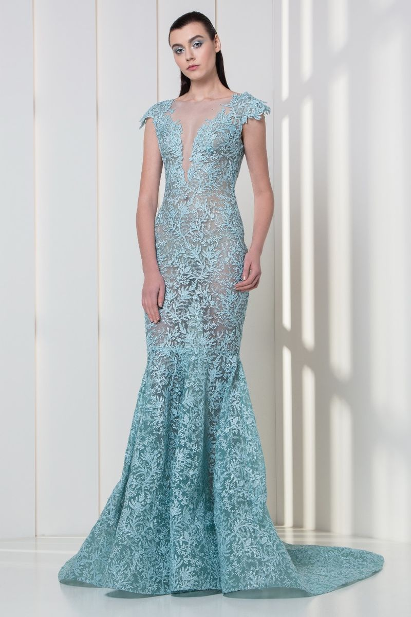 Ice blue mermaid dress with V-neckline and cap sleeves, with frost-shaped embroideries.