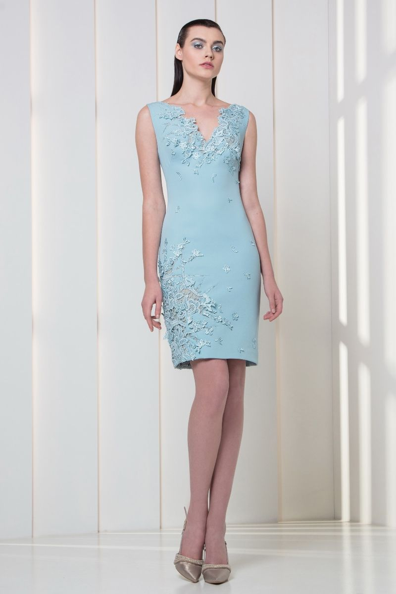 Light blue cocktail dress in silk crepe, embellished with flowery appliques.