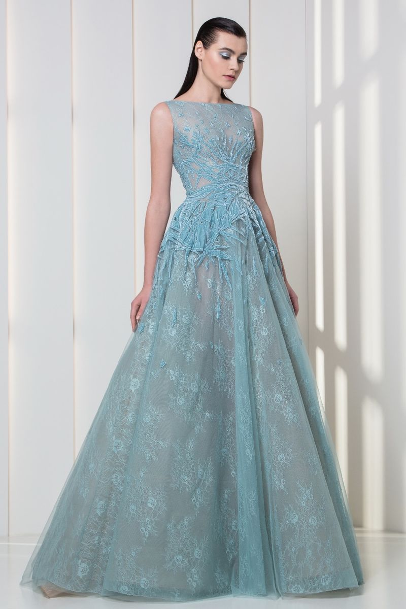 Ice blue A-line tulle and lace dress with sheer neckline and velvet embroideries.