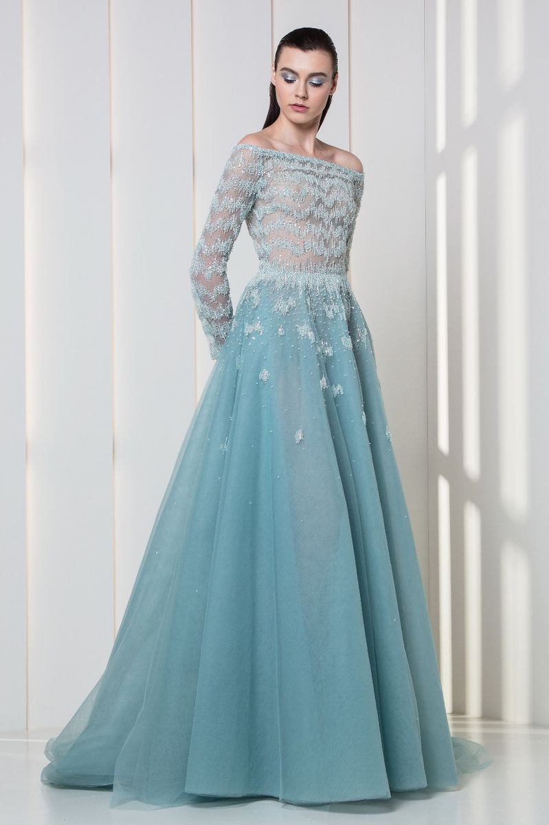 Ice blue off-the-shoulder tulle dress with long sleeved embroidered bust.