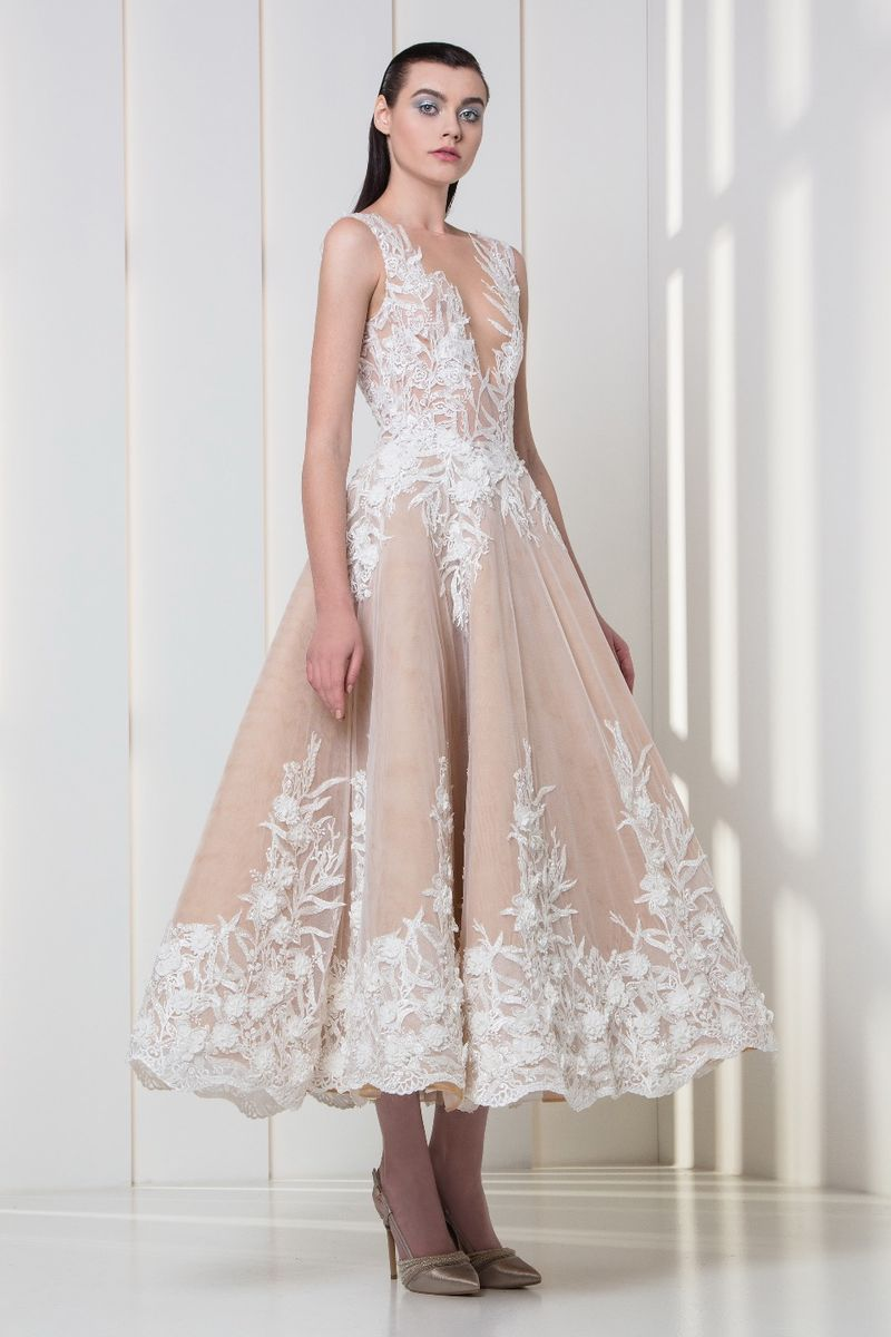 Midi-length nude dress in embroidered tulle, with white silk embellishments on the bodice and hemline.