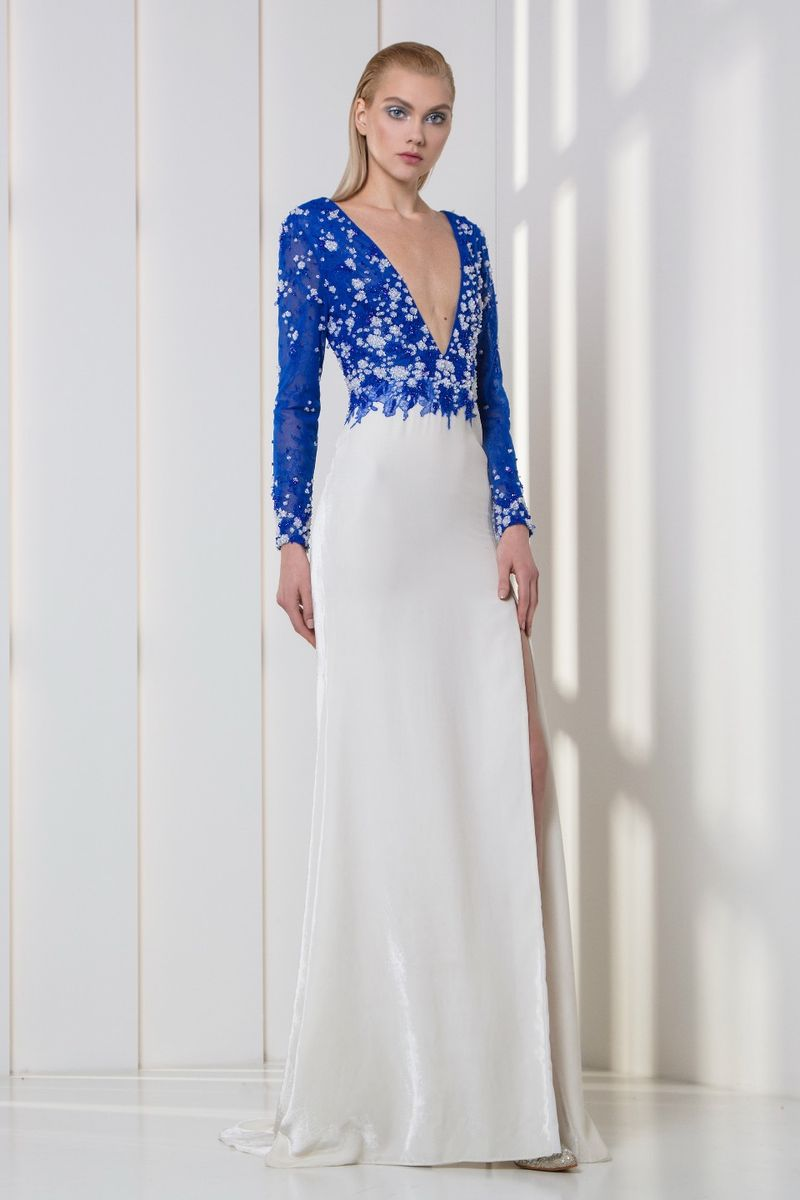 Ultra marine and white deep-V dress, featuring a lace bodice embroidered with white sequins and crystals, and a velvet skirt with a side slit.