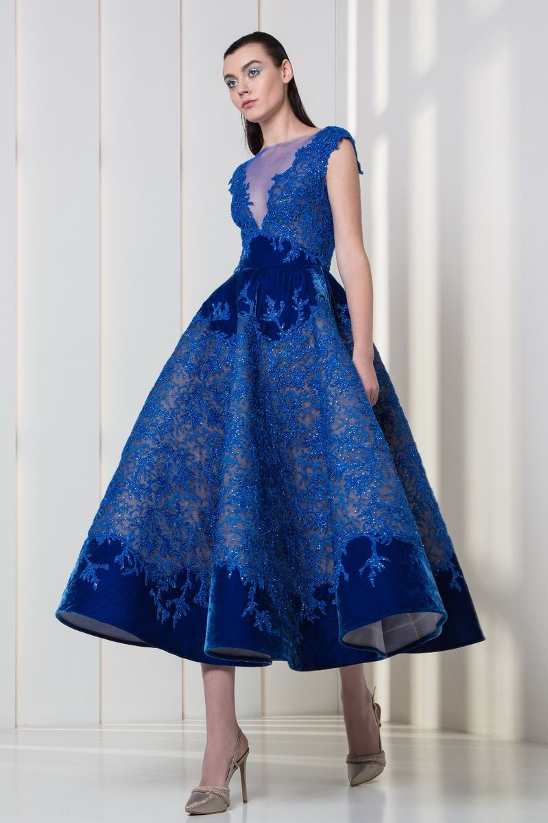 Midi-length ultra marine dress with V-neckline, frost-shaped ice blue embroideries and velvet on the waist and hemline.