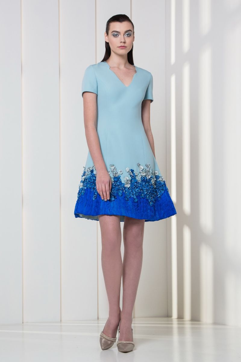 Light blue crepe cocktail dress with ultra marine silk organza, pearls and 3D flowers on the hemline.