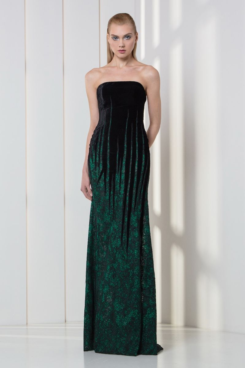Dark green strapless lace and velvet dress featuring linear plunging shapes.