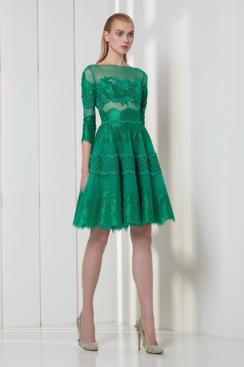 Emerald lace cocktail dress with flounced skirt and ¾ sleeves.