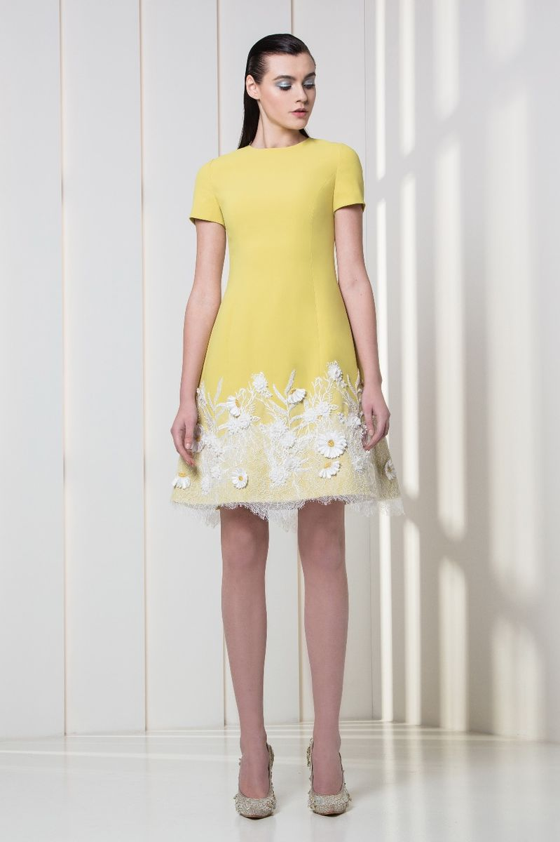 Amber yellow crepe cocktail dress, with white flower appliques on the hemline.