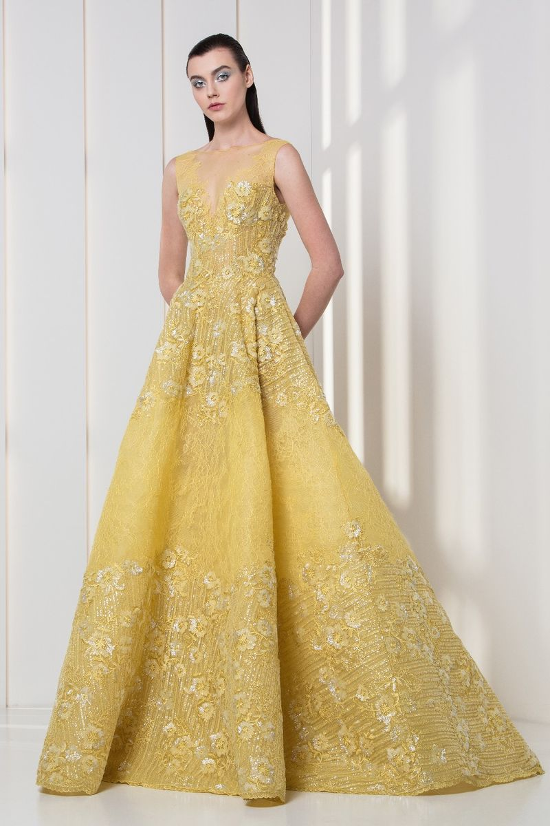 Yellow A-line dress in lace and tulle, featuring flower embroideries and sequins.