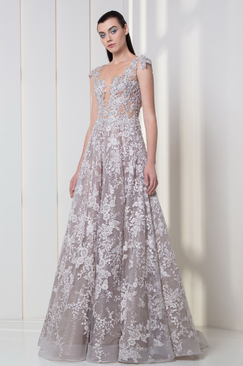 Silver lilac dress in tulle, embroidered with sequins, pearls and flowery appliques.