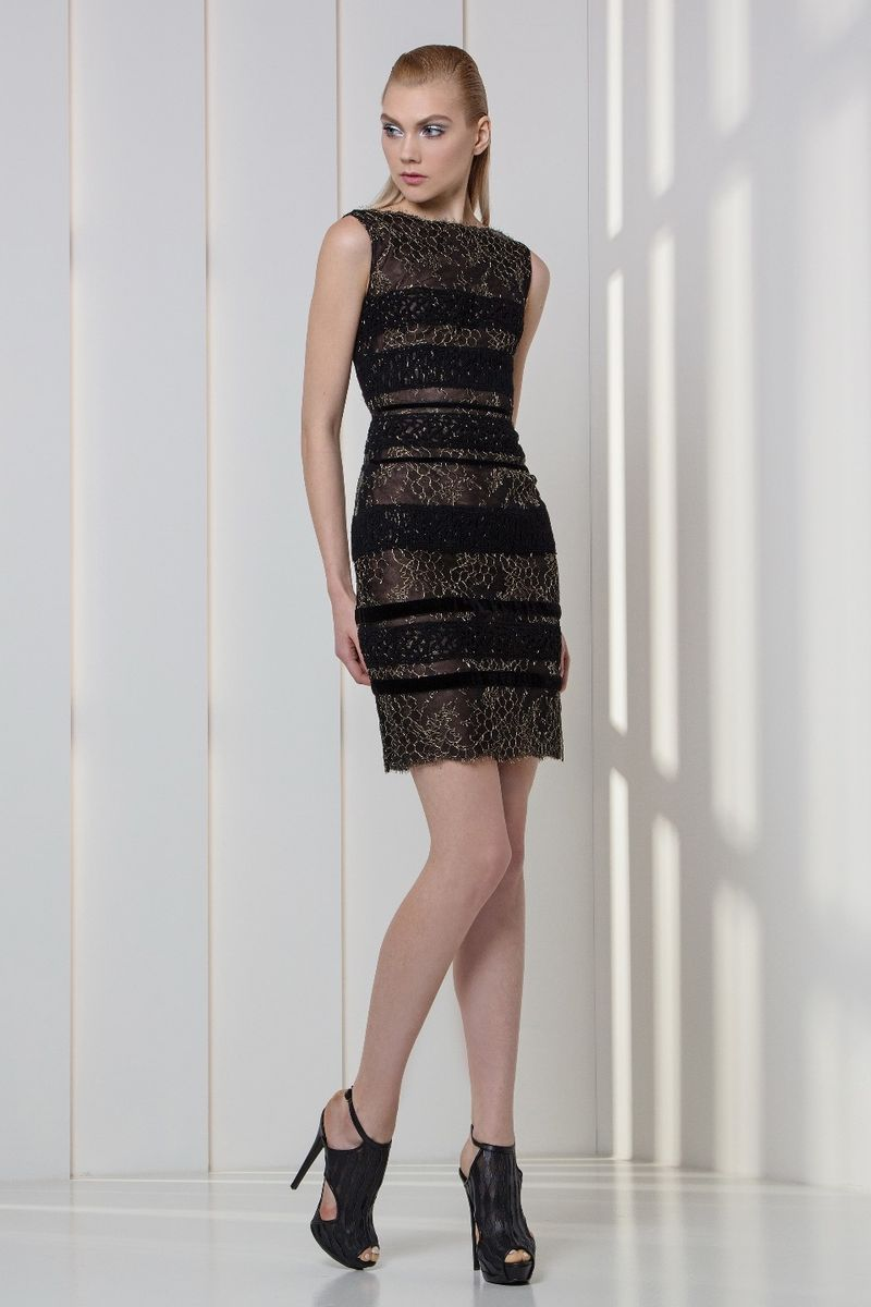 Black lace cocktail dress, featuring gold embroideries on lace and velvet bands.