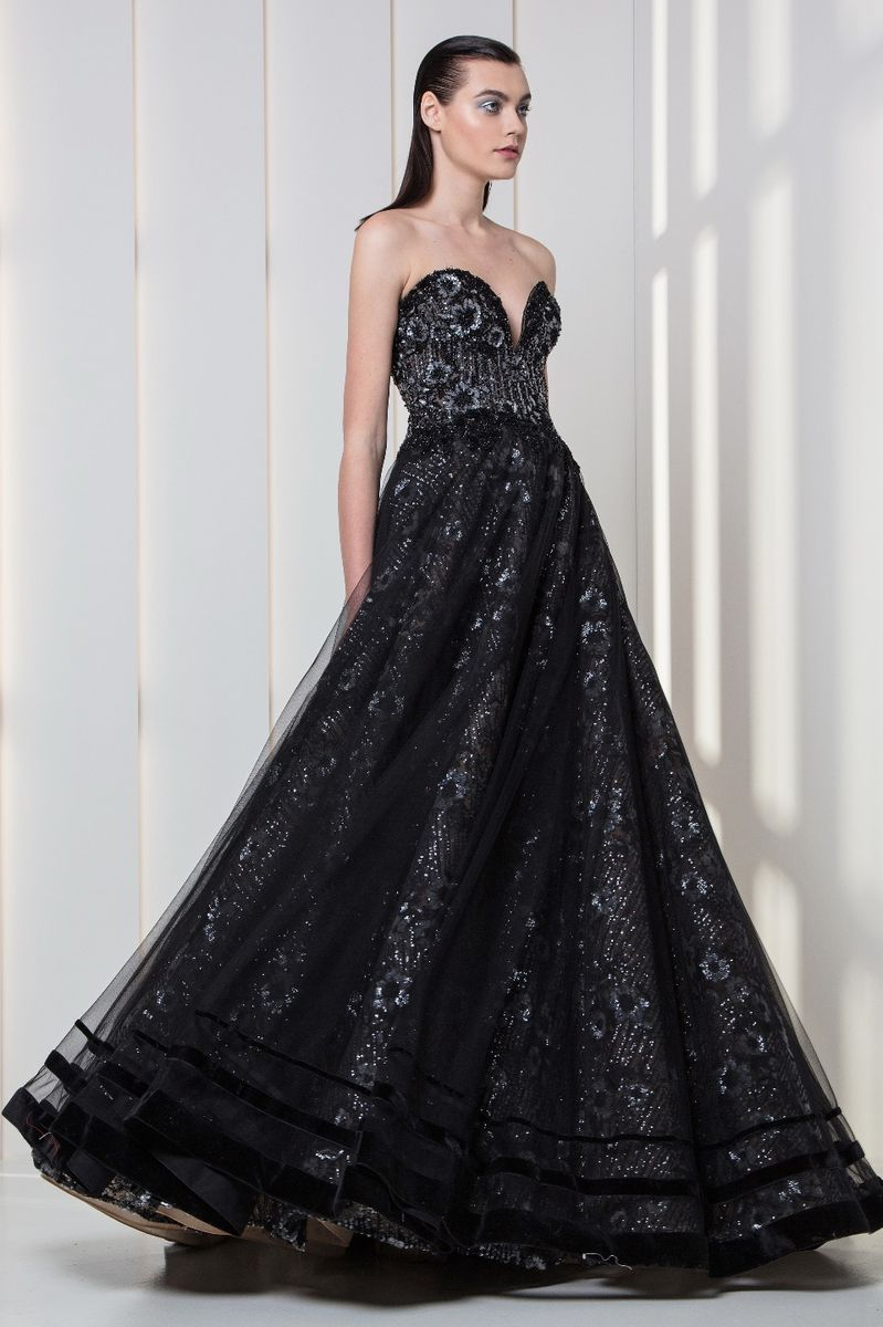 Charcoal black sweetheart dress in embroidered tulle with silver sequins and velvet bands on the hemline.