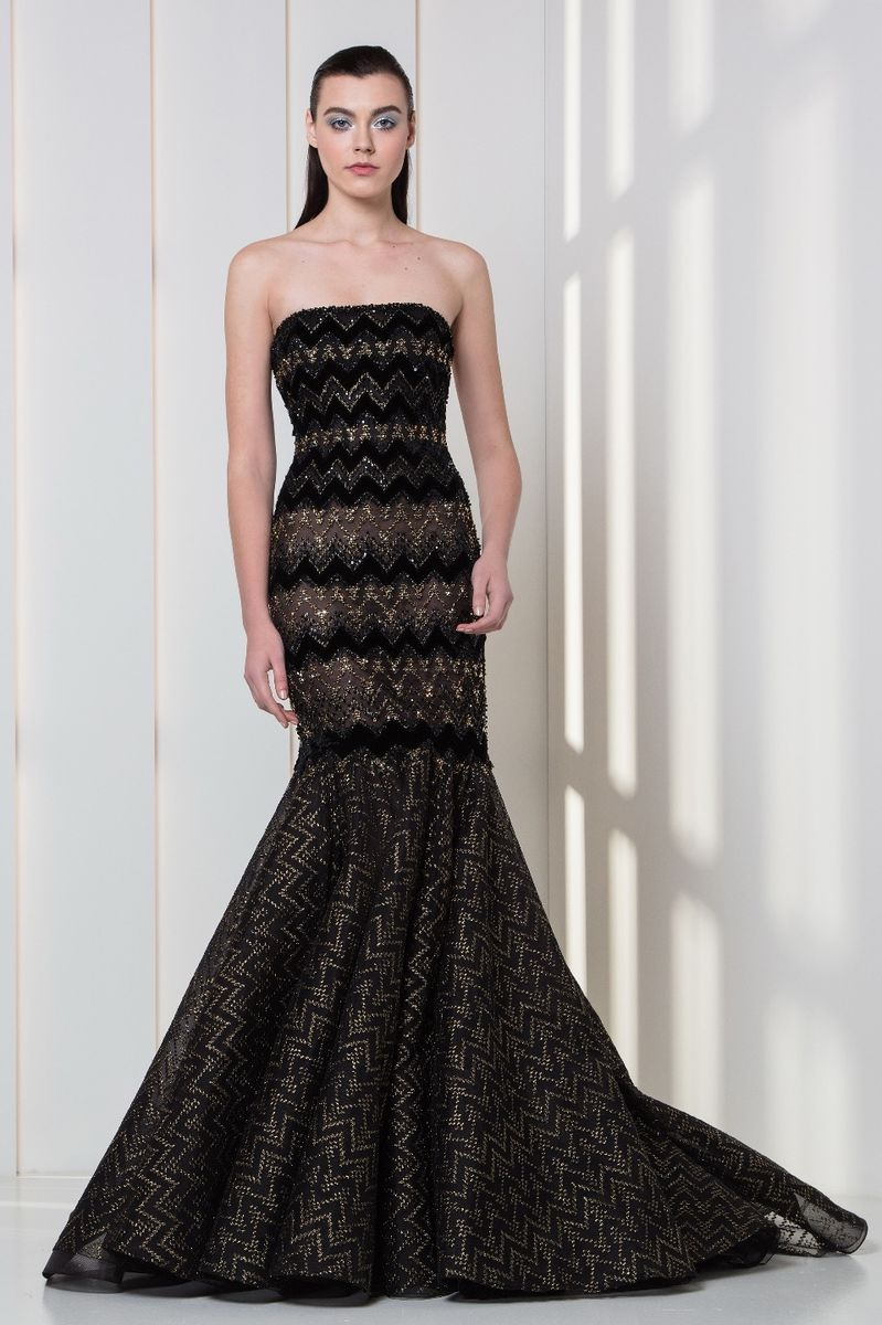 Strapless mermaid dress in black and gold embroidered tulle and velvet.