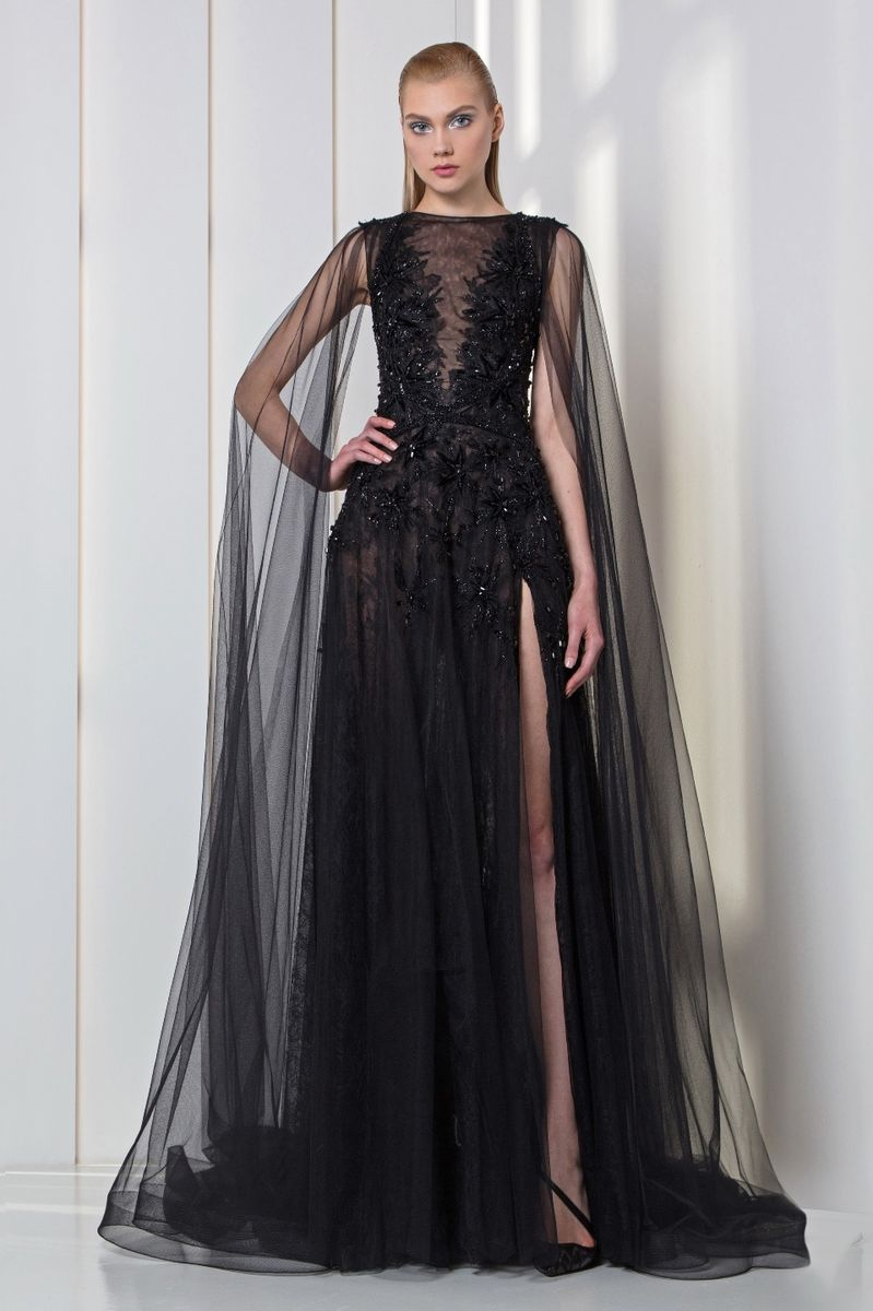 Charcoal black lace and tulle dress with velvet embroideries and a cape.