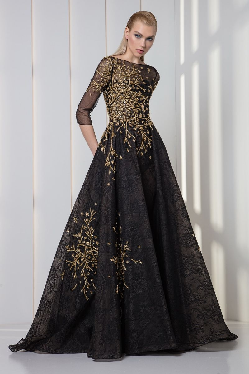 Charcoal black lace and tulle dress with ¾ sleeves and gold sequins and crystal embroideries.