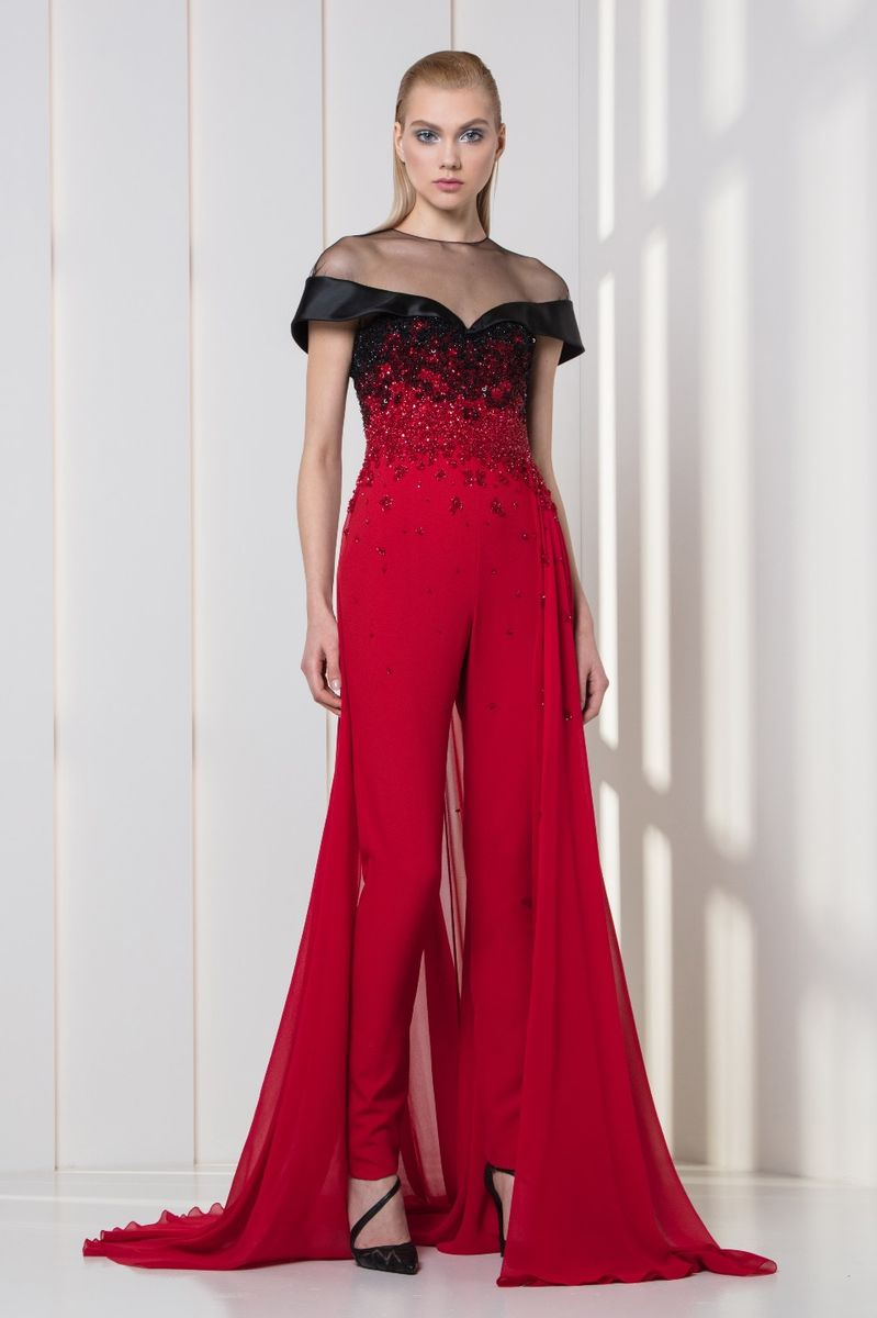 Cherry red crepe jumpsuit with an overskirt, featuring embroideries on the bodice and a black off-the-shoulder satin duchesse collar.