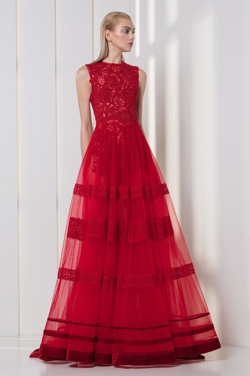 Cherry red A-line dress with a flowery guipure bodice and a tulle skirt featuring macramé and velvet bands.