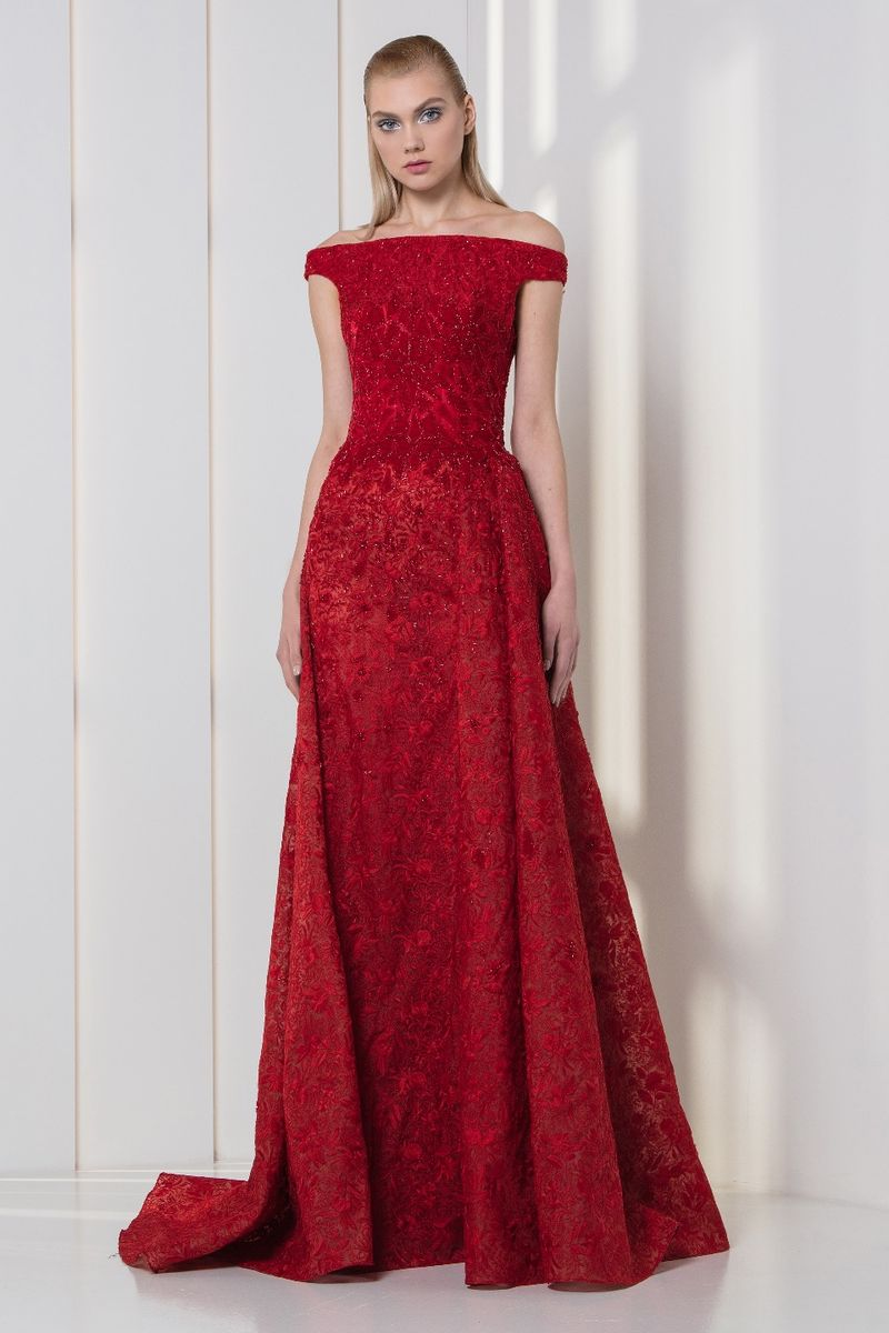 Off-the-shoulder red organza dress with embroideries, velvet appliques on the bodice and an overskirt.