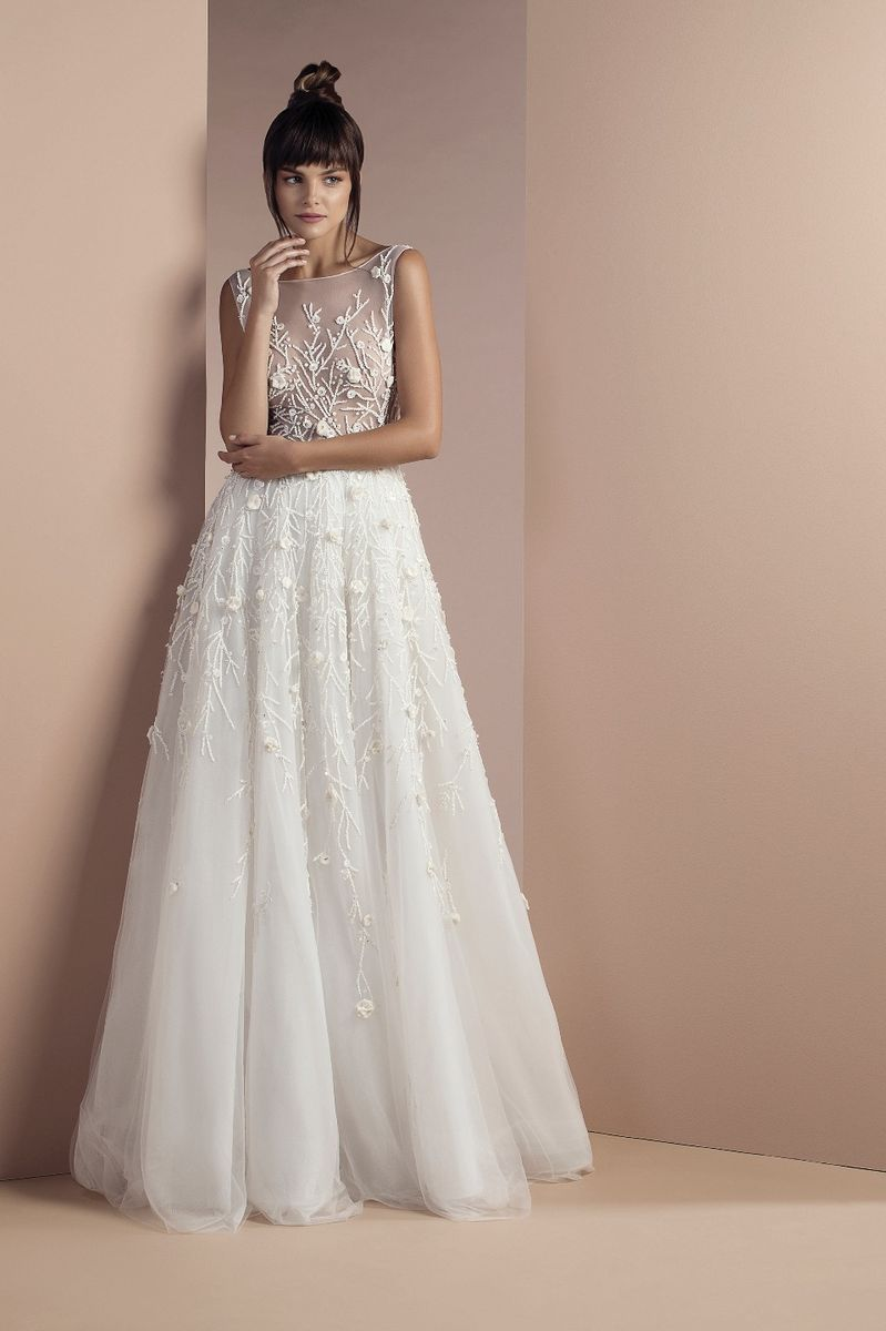 Off white tulle dress with cascading branches and organza flowers embroideries, a sheer neckline and a Court train.