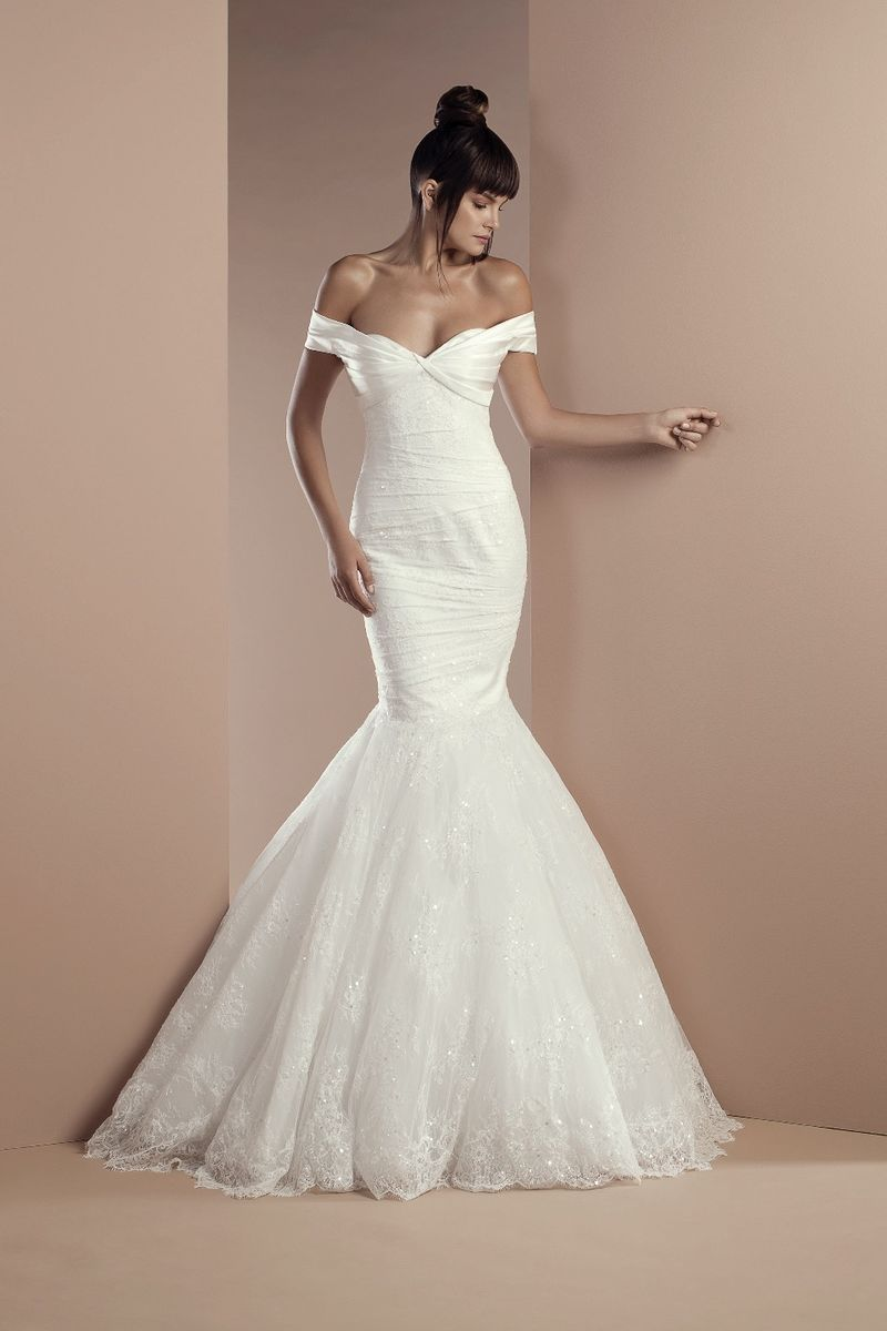 Off-the-shoulder off white mermaid dress in embroidered lace and satin with a Chapel train.
