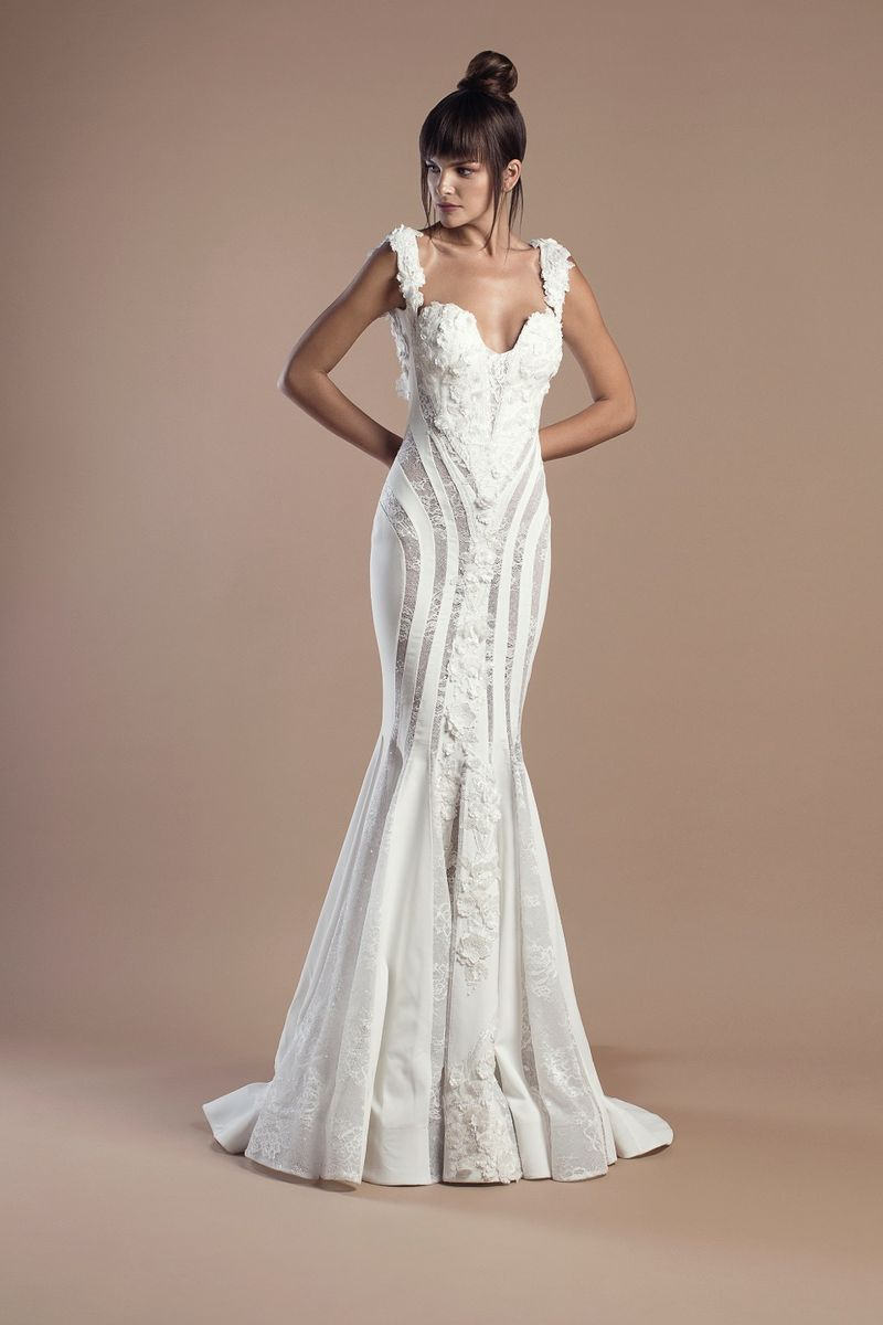 Off white mermaid dress in crepe and lace with flower appliques and a Chapel train.