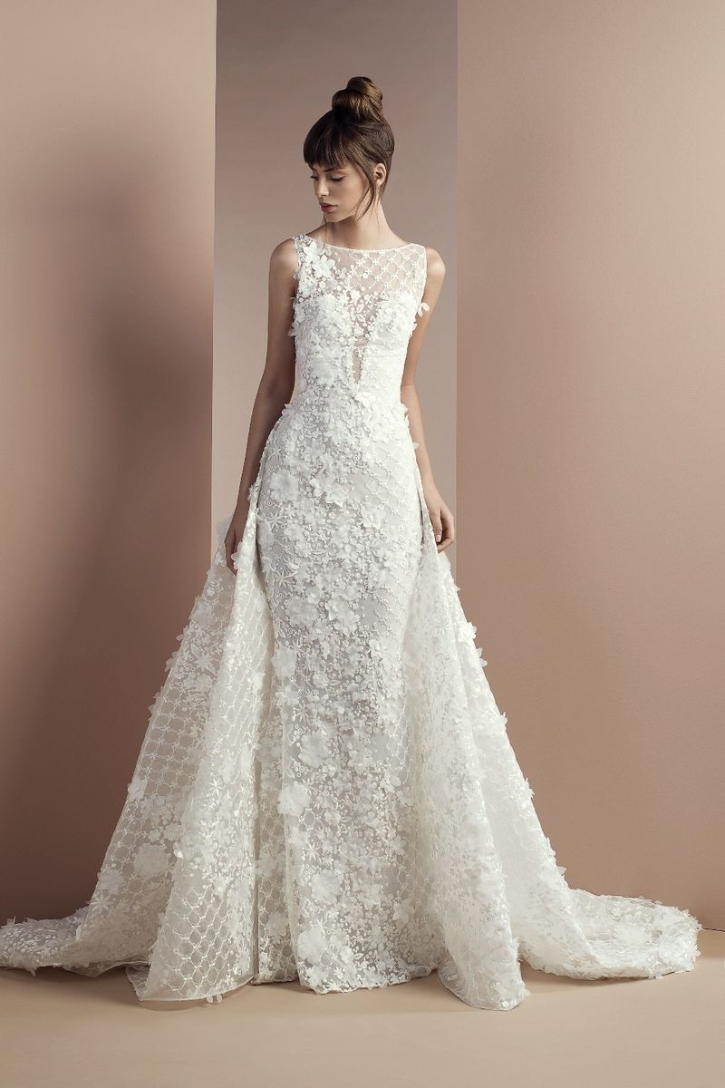 Off white lace dress with bateau neckline and an overskirt with a Chapel train.