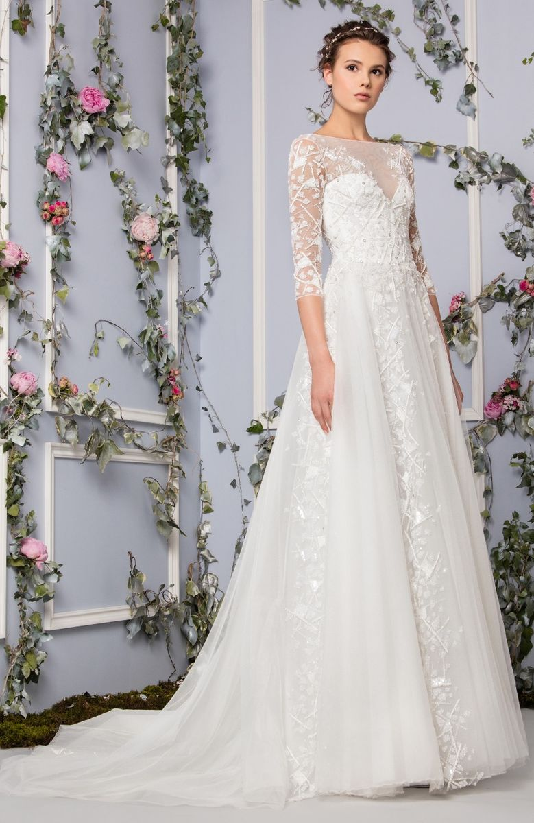 4ccc61f5d47d Off White Tulle evening dress embellished with patchwork embroidery  assembled on the bodice and a full